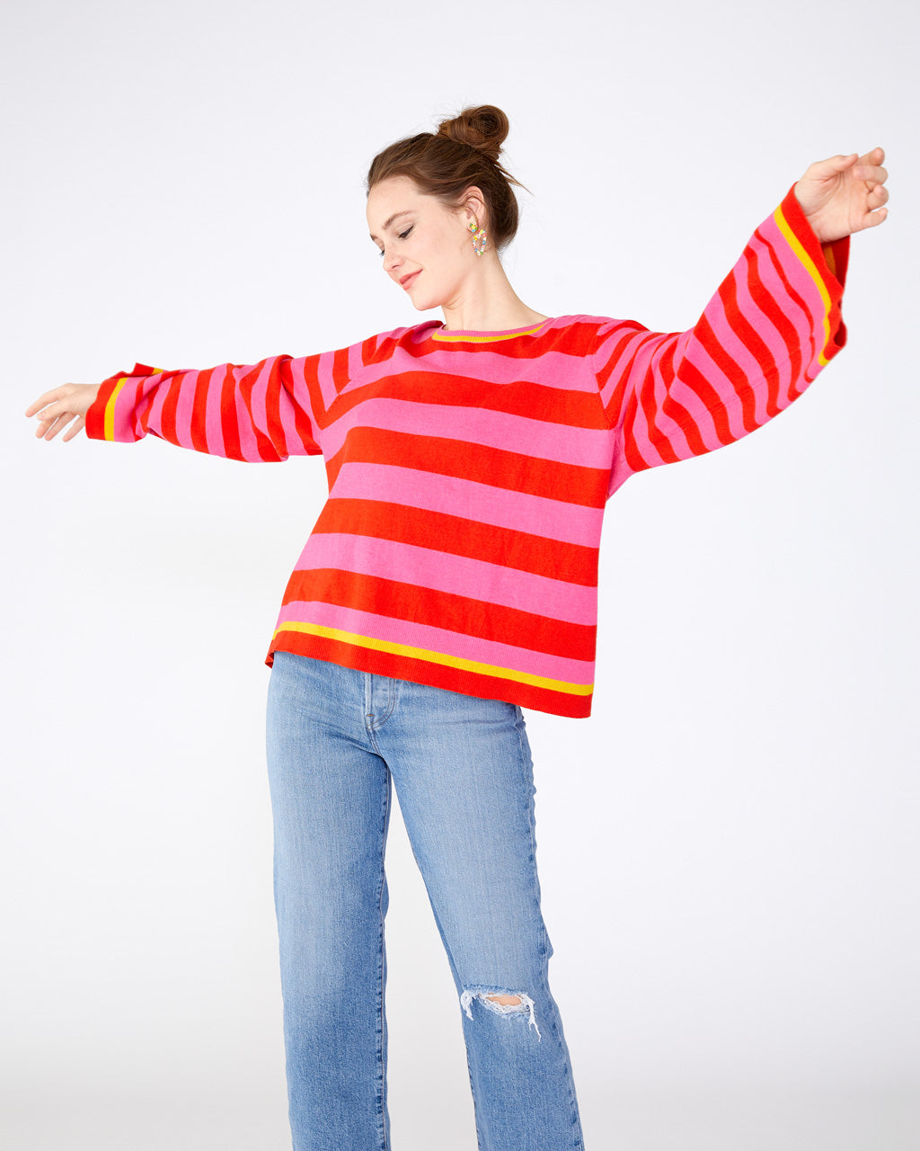 pink and red striped bell sleeve with a yellow striped accent at the trim
