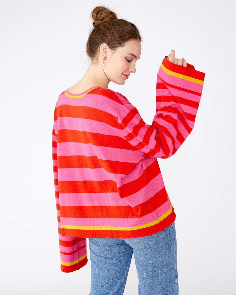 pink and red horizontal stripe sweater with bell sleeves