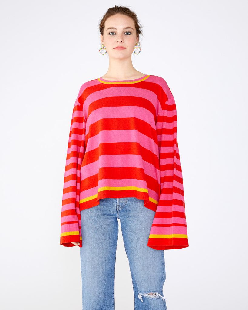 pink and red horizontal striped sweater with a loose fit