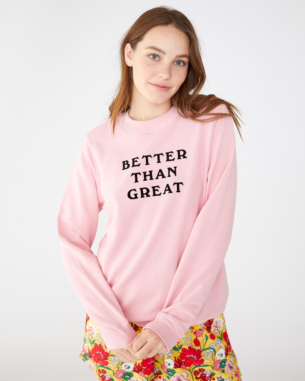 Light pink long sleeve sweatshirt with the words better than great printed in black on the front