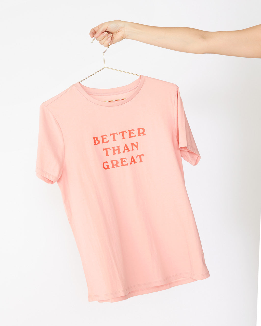 "Light pink crewneck tee with ""Better Than Great"" printed on the front center in darker pink text"