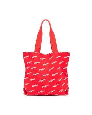 This lightweight canvas tote comes in red, with a pattern of 'Bonjour' printed in white.