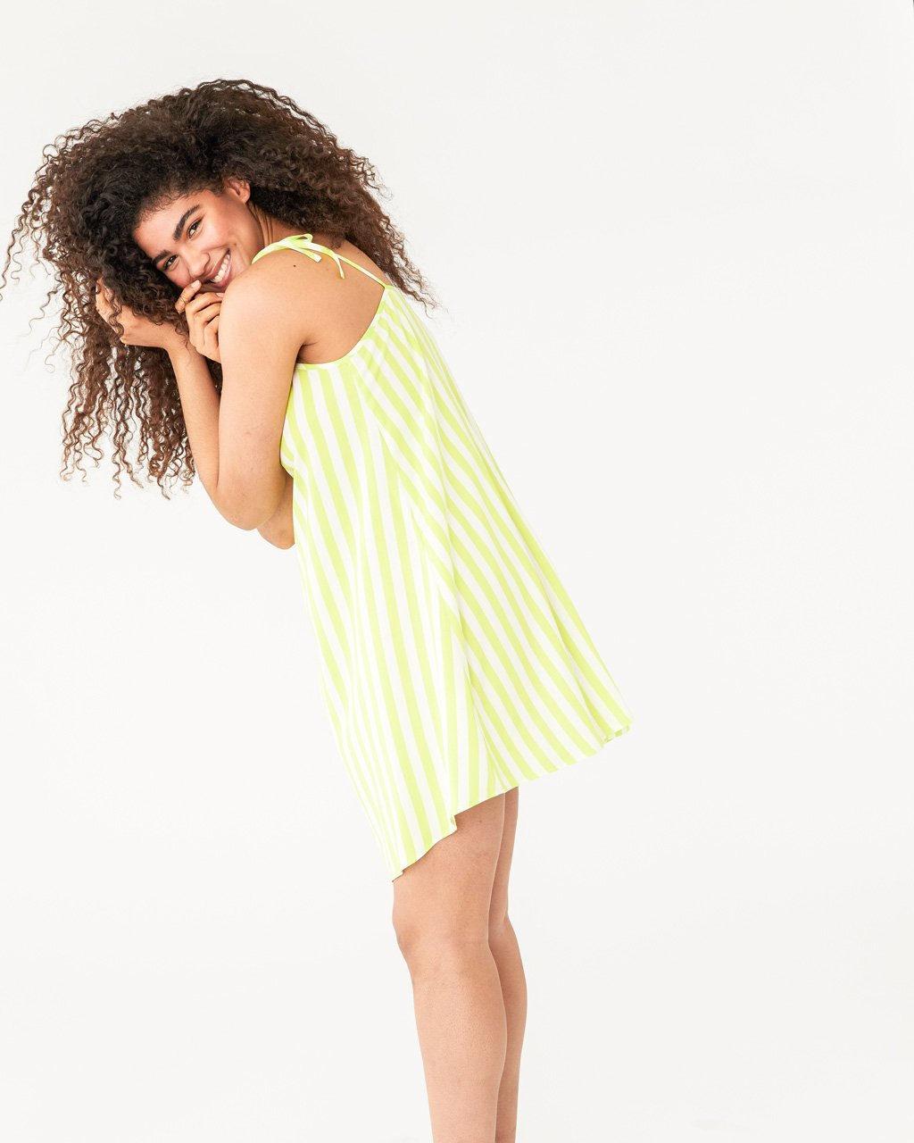 model wearing our lime green stripe breezy dress