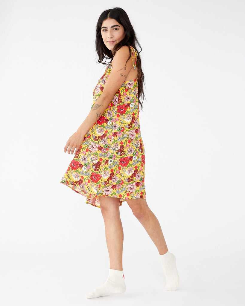 Sunshine super bloom featured on our breezy tank dress with a baby doll fit