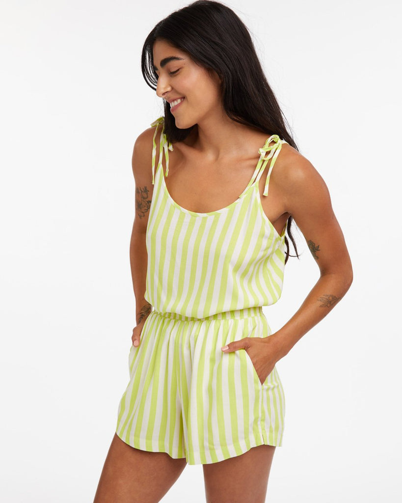 model wearing lime green stripe breezy tank with matching shorts