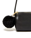 Handmade synthetic wool pom-pom attaches to metallic gold zipper pull.