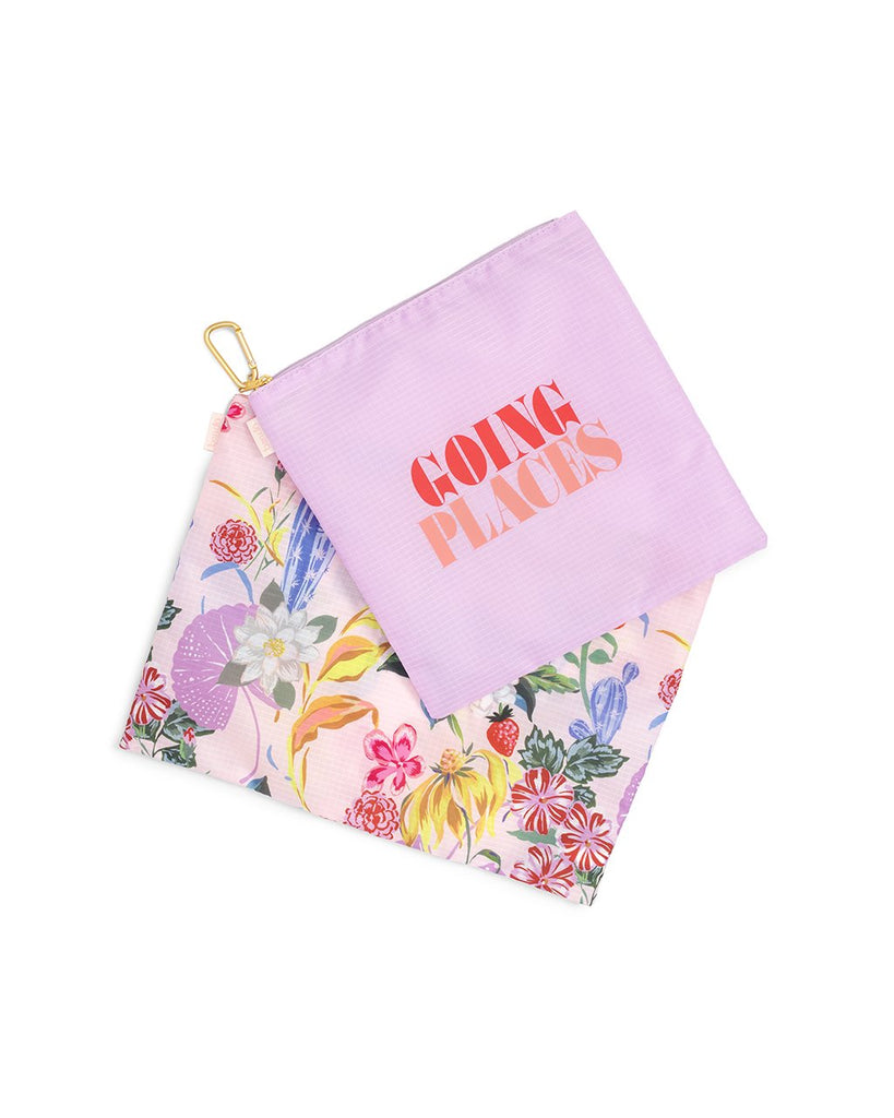 large carry all duo shown with a large floral pouch and a smaller purple pouch with the words going places