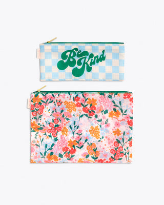 "2 flat pouch set. 1 in blue and white checker with ""Be Kind"" text graphic in green. 1 in pink floral pattern"