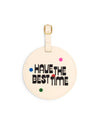 The Getaway Luggage Tag comes in off-white, with rainbow spots and 'Have the Best Time' printed in black on the front.