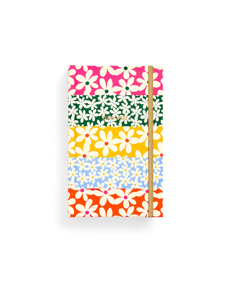 classic 17 month planner with a multi colored daisy pattern