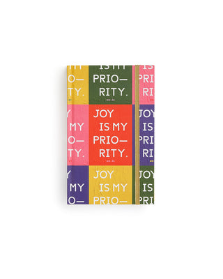 classic 17 month planner with a color block design and the words joy is my priority