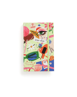 classic 17 month planner with green cover featuring an abstract design
