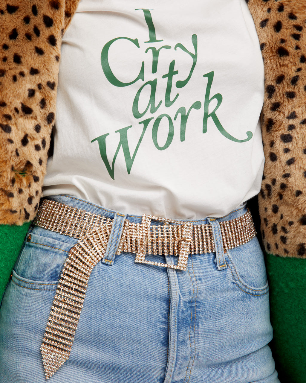White short sleeve tshirt with green graphic.