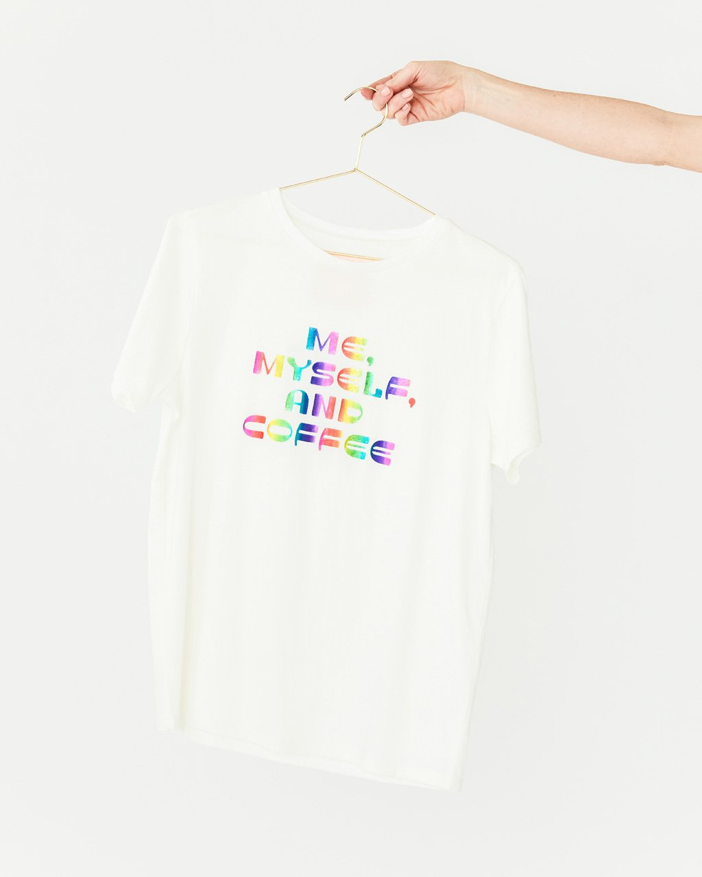 solid white tee with the words me myself and coffee in metallic multi colors shown on hanger