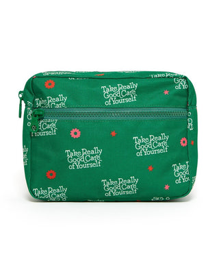 "Green costmetic bag with repeated quote pattern "" take really good care of yourself"""