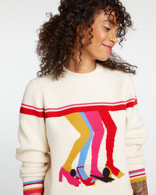 Cream knit sweater with colorful boogie shoes graphic.