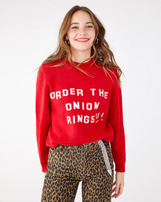 Red sweater with white lettering that reads Order The Onion Rings.