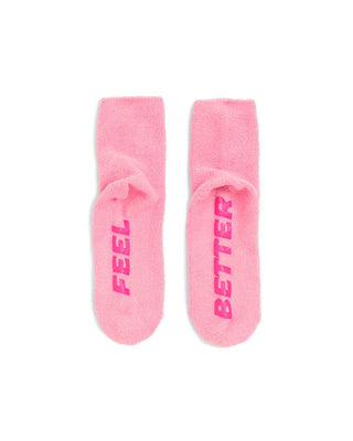 Pink socks with Feel and Better on the sole.