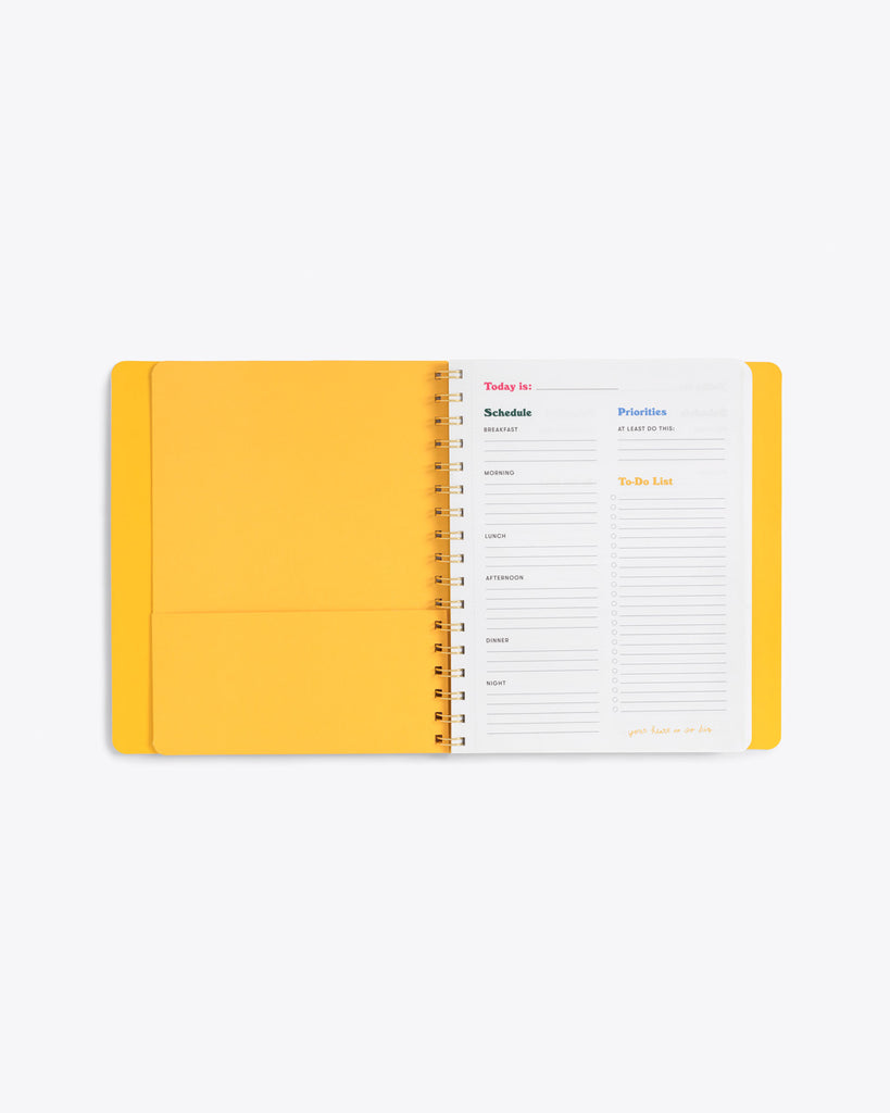 interior image of to do planner featuring daily layout and bright yellow end sheet with pocket
