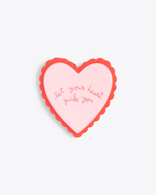 heart shaped de-stress ball with the words reading let your heart guide you