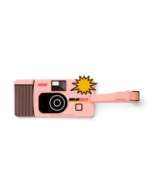 Silicone luggage tag made to look like a disposable camera with an adjustable strap..