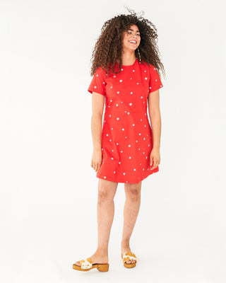red knee length short sleeve dress with white dresses all over shown on model