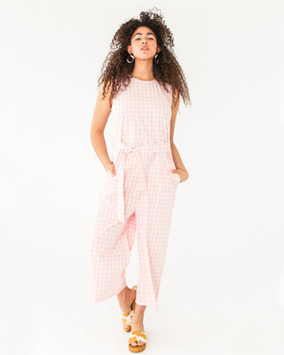 white and pink picnic plaid tank jumpsuit with tie belt shown on model