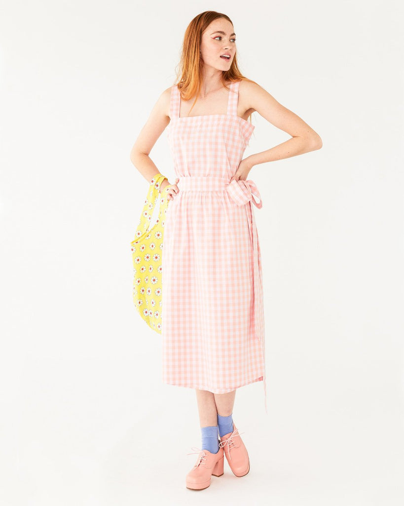 model wearing white and pink picnic plaid tank with matching skirt and pink heeled shoes with blue socks
