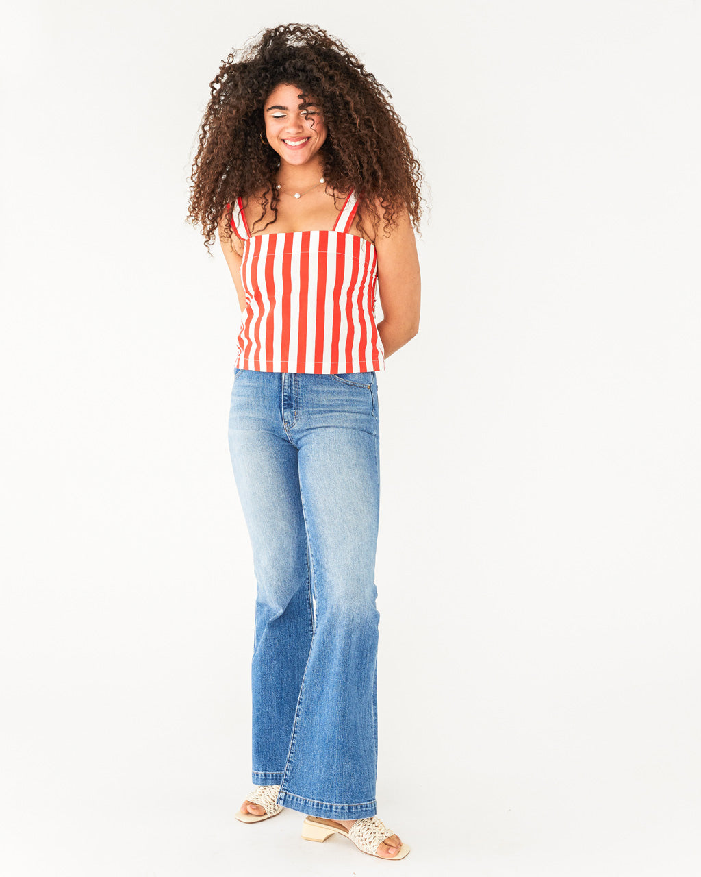 red and white stripe tank shown on model paired with jeans