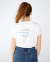 white tee with word art on the back