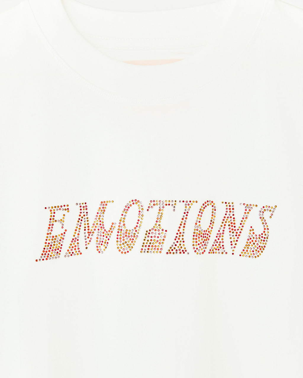 white tee with the word emotions in rhinestones