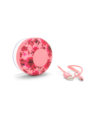 Bluetooth speaker with pink floral pattern.