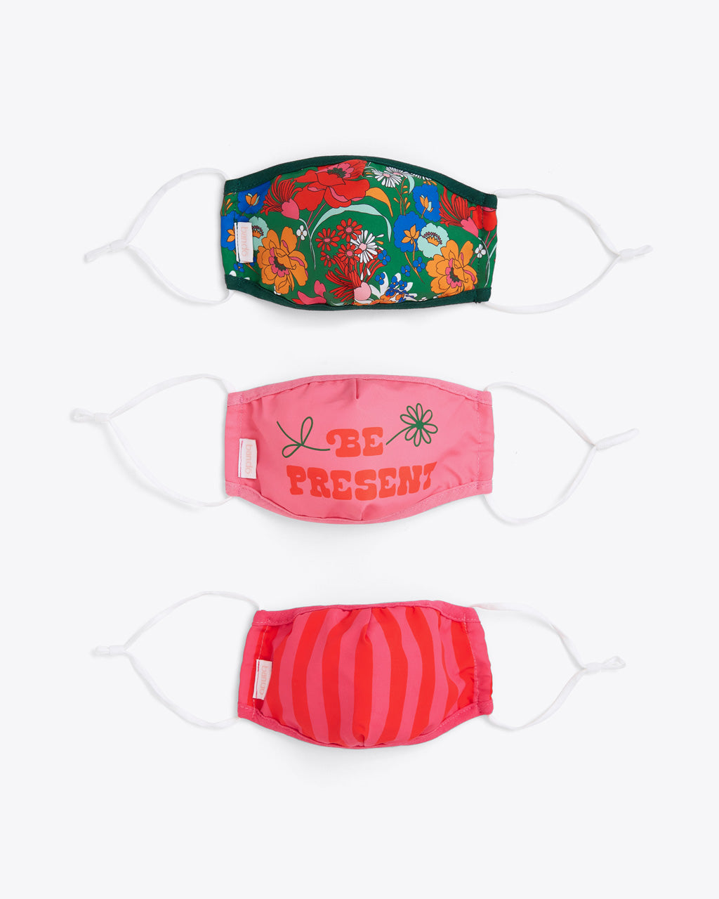 "set of 3 fabric face masks in green superbloom pattern, pink with ""Be Present"" graphic, and pink and red stripe pattern"