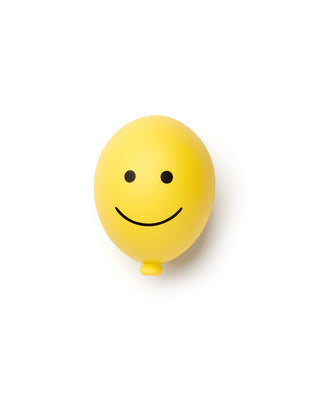 Yellow smile face ballon stress ball.