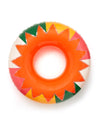 Giant inflatable inner tube with bright orange sun design