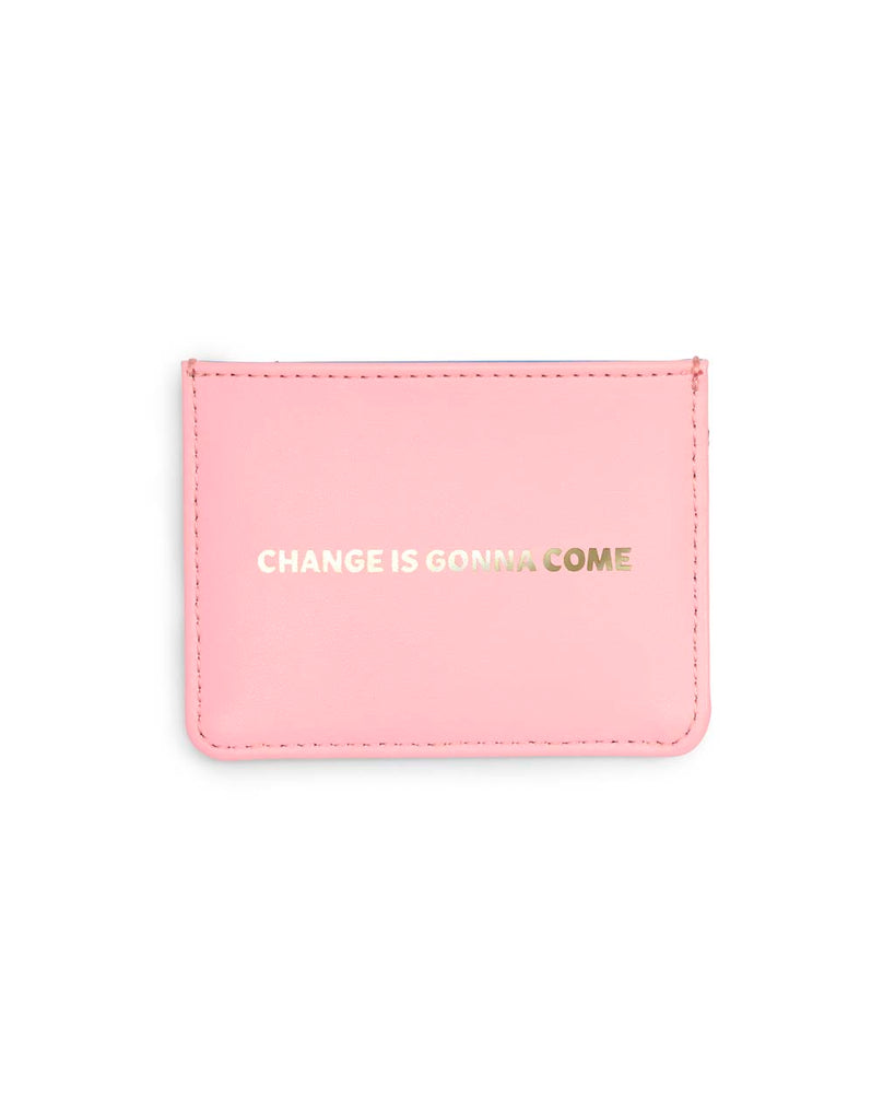 This Get It Together Card Case comes in pink, with 'Change Is Gonna Come' embossed in gold foil on the front.