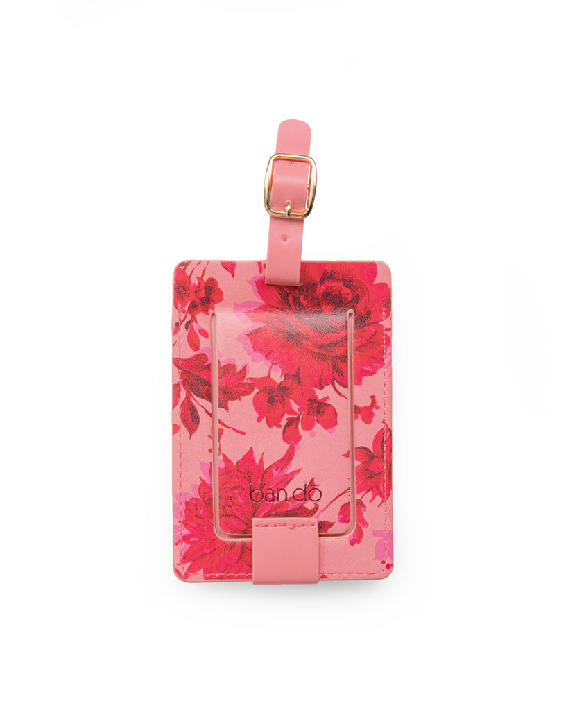 Back shot of leatherette luggage tag in a pink floral motif.