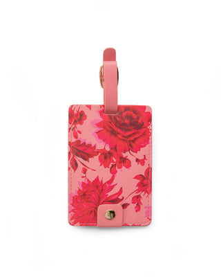 Leatherette luggage tag in a pink floral motif.