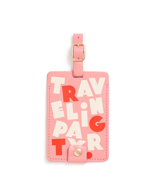 This Getaway Luggage Tag comes in pink, with 'Traveling Party' printed in red and white on the front.
