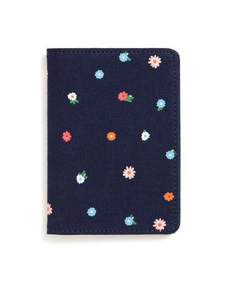 This Getaway Passport Holder comes in deep navy, with a rainbow polkadot pattern throughout.