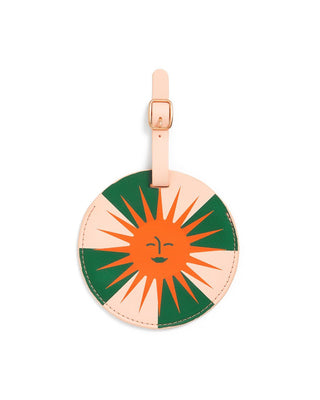 Round luggage tag with bright orange sun design