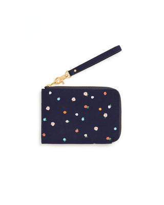 This Getaway Travel Clutch comes in deep navy, with a rainbow polkadot pattern throughout.