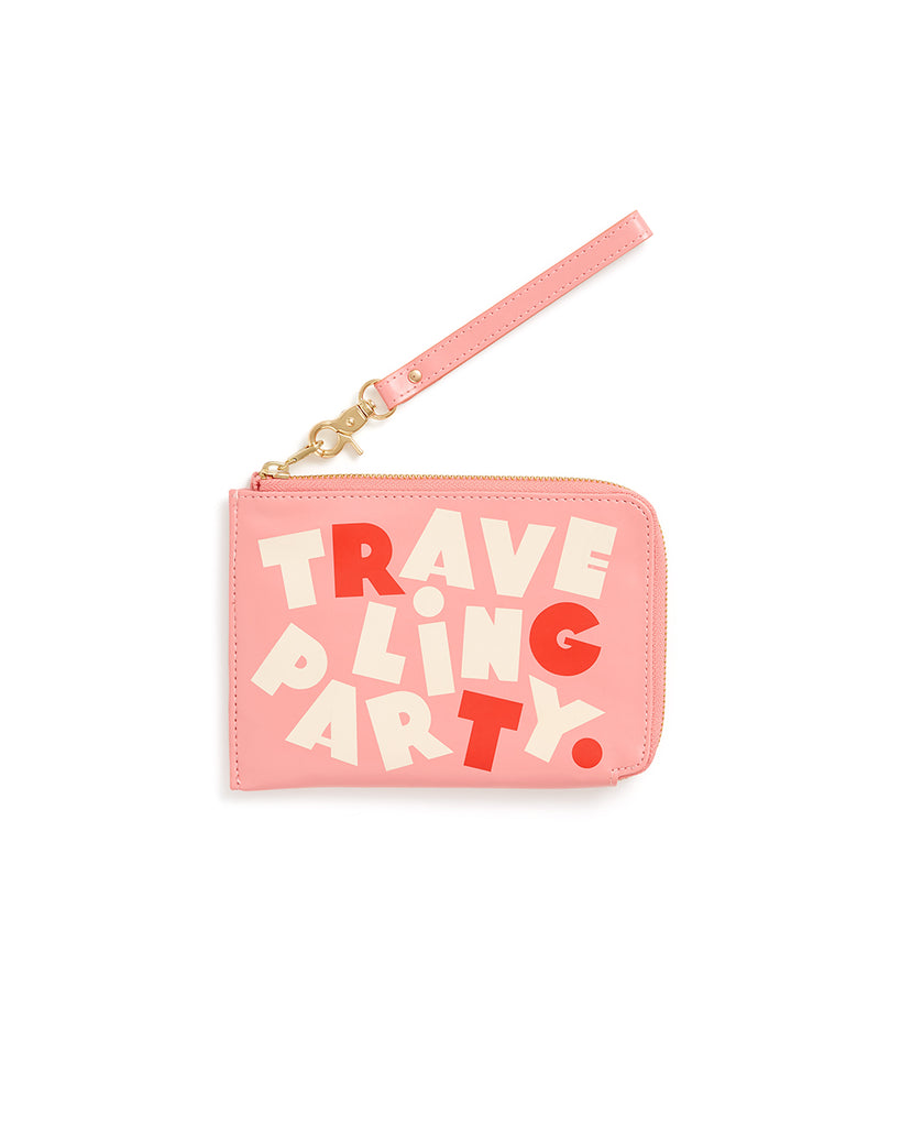 This Getaway Travel Clutch comes in pink, with 'Traveling Party' printed in red and white on the side.