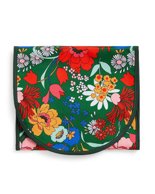 Emerald green nylon exterior travel organizer with bright floral pattern