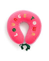 Hot pink travel pillow with green ribbon closure