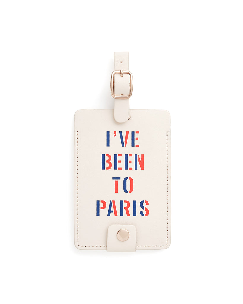 This Getaway Luggage Tag comes in white, with 'I've Been To Paris' printed in red and blue on the front.