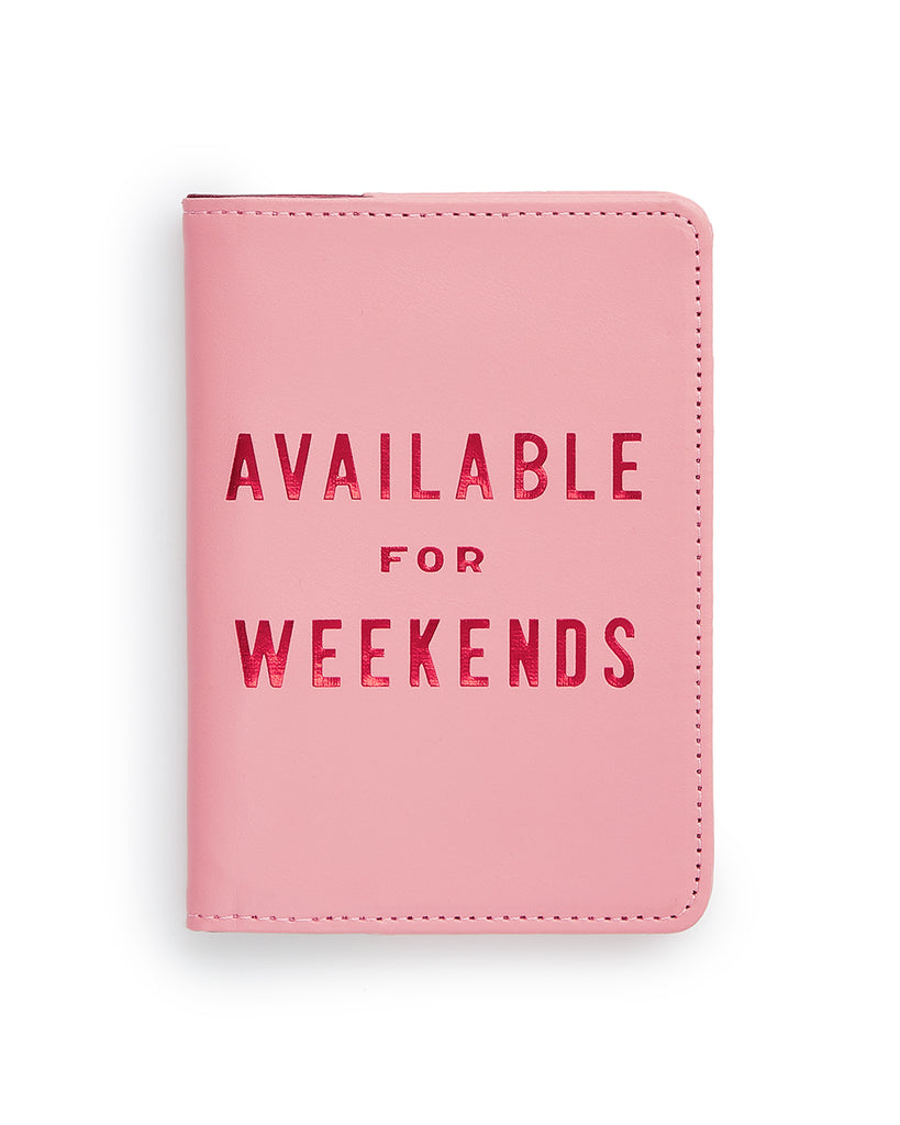 This Getaway Passport Holder comes in pink, with 'Available For Weekends' printed in pink on the front.