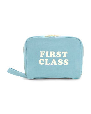 "light blue bag with text that reads ""FIRST CLASS"""