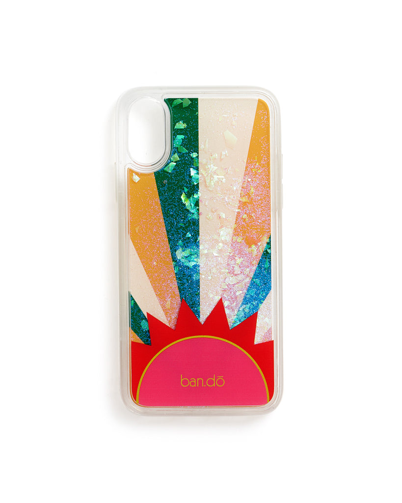 large and small pieces of acrylic floating in an iphone case printed with a colorful sunburst illustration