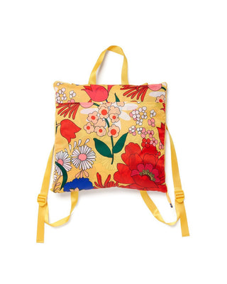 Yellow outdoor blanket with floral pattern that folds into a backpack with nylon straps